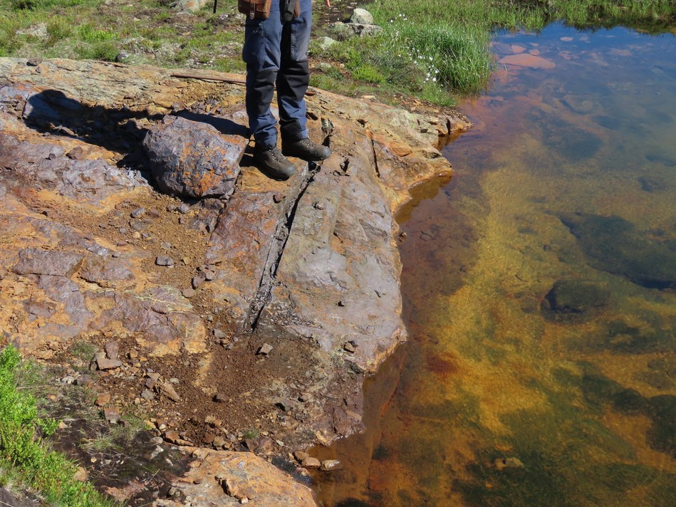 Figure 2. Oxidized massive sulfide outcrop at the Kjøli project in which channel sampling returned 2.2% Cu. (CNW Group/Capella Minerals Limited)