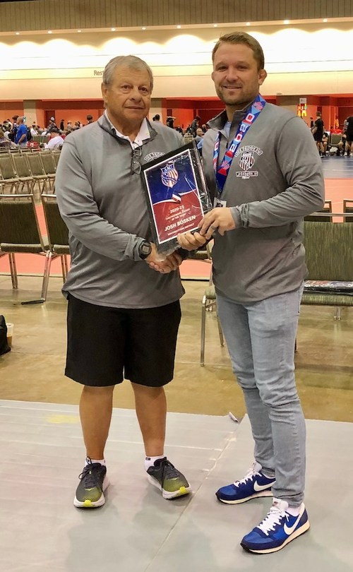 Bosken is pictured with AAU Executive Committee Member Dave Bennets at the organization's award ceremony this week in Orlando, Florida.