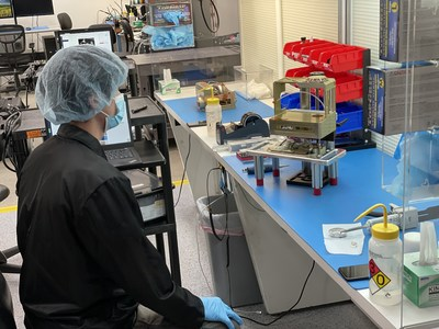 Two Maxwell Block 1 top level assemblies being integrated side by side during a production Run by technician Josh Lopez, before heading into software acceptance testing