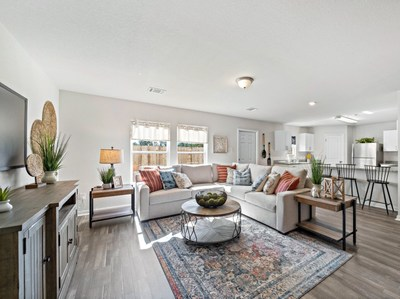 Model home great room by Century Complete