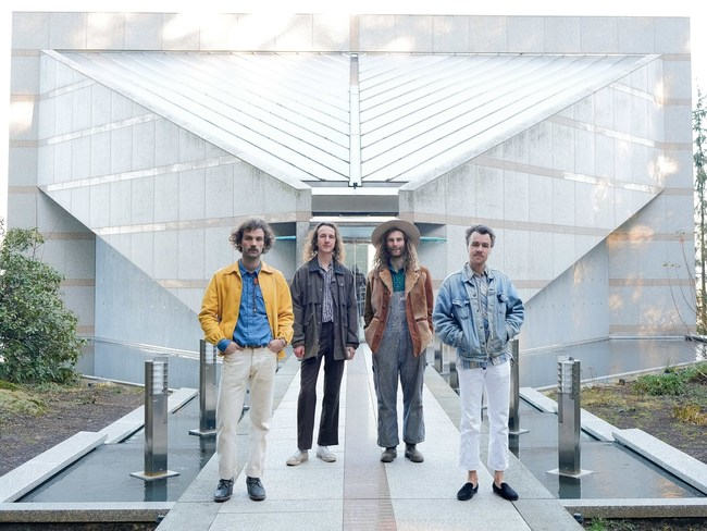 WEEED band members standing in front of building