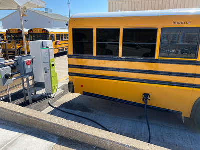 Nuvve DC V2G Charging Station from Rhombus Energy Solutions charging a Blue Bird school bus.