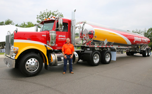 40-year driver, Daniel Abshire, stands near his custom Peterbilt truck that Pilot Company surprised him with for his years of service during a luncheon on July 7 at the company's headquarters in Knoxville, Tenn.