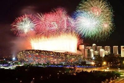 Photo shows fireworks explode over the National Stadium. (Photo by Xinhua News Agency)