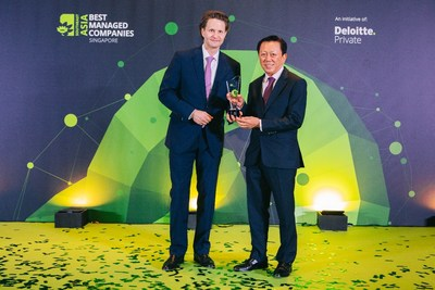 Chairman Mr Patrick Chong & Group CEO Dr Wolfgang Baier of LUXASIA receiving the Singapore's Best Managed Companies award, conferred by Deloitte (PRNewsfoto/LUXASIA)