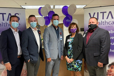 VITAS Healthcare commemorated the official grand opening of the new inpatient hospice unit with a ribbon-cutting ceremony on June 30, 2021.  From left: AdventHealth Lake Wales CFO Justin Hengesbach, Executive Director of Operations Jason Shockey, and President & CEO Royce Brown with VITAS general managers Deborah Totten and James Rogers.