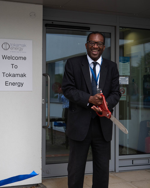 Kwasi Kwarteng the Secretary of State for Business, Energy and Industrial Strategy, cutting ceremonial ribbon to mark Tokamak Energy's expansion plans.