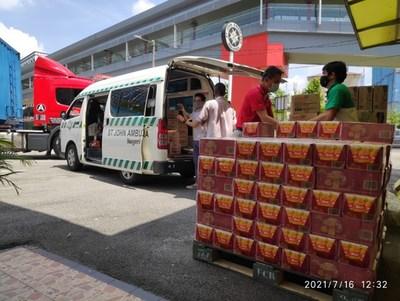 Yeo's Food Aid distributed to communities across Malaysia with St John's Ambulance vehicles. (PRNewsfoto/Yeo Hiap Seng (Malaysia) Bhd.)