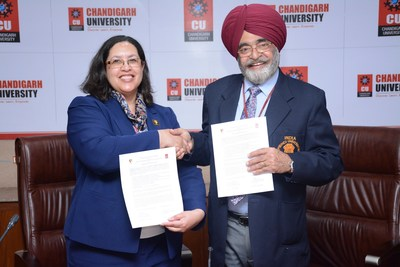 Officials from University of Maryland, USA and Dr. R.S.Bawa exchanging the Academic MoU documents under the International Academic Alliance Program.