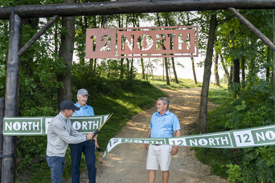 Course Architect Craig Haltom, left, along with golf legend Andy North and Todd Nelson, right, club owner, cut the ribbon to open 12North a new par-three course at Trappers Turn Golf Club in Wisconsin Dells, Wis., Monday, July 19, 2021. 12North was designed by two-time U.S. Open Champion Andy North and the award-winning team at Oliphant Golf.(Andy Manis/AP Images for Trappers Turn Golf Club)