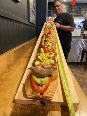 Pauli's in Boston, MA launches America's Largest Hot Dog for National Hot Dog Day.