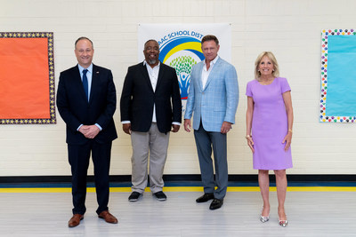 First Lady Jill Biden and Second Gentleman Douglas Emhoff visit a recent One Community Initiative Against COVID-19 testing and vaccination event at Isaac Middle School, hosted by the Equality Health Foundation. Pictured are (left to right): Second Gentleman Emhoff, Equality Health Medical Director Edmond Baker, M.D., Equality Health Founder and CEO Hugh Lytle, and First Lady Biden. Photo credit: Official White House Photo by Erin Scott.