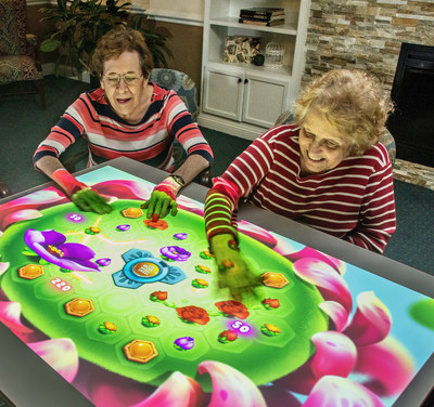 Residents at The Virginian senior living community in Fairfax, VA using Obie for Seniors interactive gaming system. The installation is part of The Virginian's 'high touch, high tech' $56.5 million renovation which will include a state-of-the-art expanded Memory Care program. The Virginian will be completely reimagined into new, luxury independent living apartment homes and a complete continuum of care. Renovations will be completed in phases through Fall 2022.