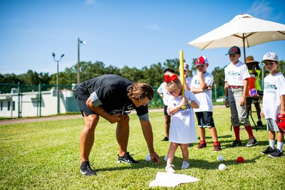 Hall of Fame pitcher, Trevor Hoffman, shares some batting tips with a Perfect Game Cares Foundation youth camp participant in St. Petersburg, FL.