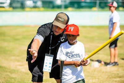 Former Major League Baseball All-Star and World Series champion, Luis Gonzalez, was one of 12 former big leaguers to join the Perfect Game Cares Foundation's recent free youth baseball and softball camp for more than 500 children from St. Petersburg, FL.