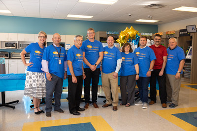 The eHealth Technologies team gathers for the Two Million Customers open house and celebration. (L to R: Susan Barnes, Account Manager; Michael A. Sciortino, Esq., Chief Legal Counsel, Chief Privacy Officer; Jeff Markin, CEO; James Norman, VP of Engineering and Technology; Craig Geller, Sales Consultant; Kathy Dutton-Fanning, Director of Marketing and Communications; Matt Hanley, Controller; Shiv Bhatia, COO; Dave Beaulieu, Director, Board of Directors)