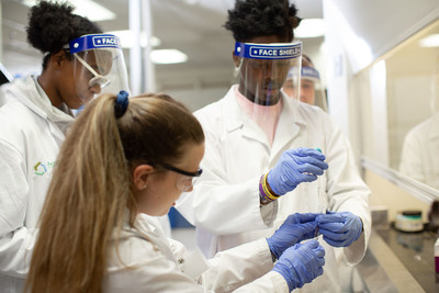 FMI students, Melly Young Jr., Dasha Hammond and Mentor, Savannah Baker performing an extraction in drug chemistry.