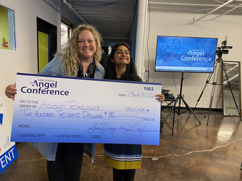 Dr. Silvia Mah, co-fund manager of San Diego Angel Conference, presents a $200,000 investment to Pradnya Desh, founder of Advocat Technologies, an artificial intelligence (AI) research and drafting solution for attorneys.