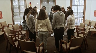 Angie: Lost Girls movie still of girls in recovery praying in church. (PRNewsfoto/Artists For Change, Inc.)