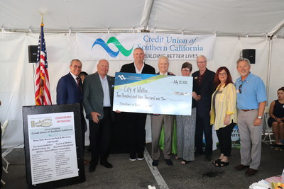 Wake Up Whittier Check Presentation: (Pictured left to right) Corporate Advisory Board Member Gil Rodriguez, CU SoCal SVP Eric Day, CU SoCal Board Member Chris George, CU SoCal President and CEO Dave Gunderson, Whittier Mayor Pro Tem Cathy Warner, Whittier Mayor Joe Vinatieri, Whittier Chamber Board Chair Sandra Hahn, and Whittier Councilman Fernando Dutra present a check representing the combined $209,000 given to Whittier charities during the Wake Up Whittier event Wednesday, July 21.