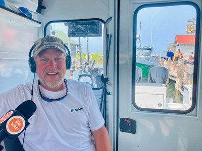 """FishBilly Charters Captain Bill Stephenson aboard his HewesCraft 270 Alaskan fishing boat in Leland, Michigan recording """"Fish Stories"""" for Lick the Plate Michigan with host David Boylan."""