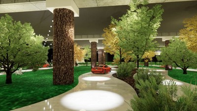 """The New York Auto Show's EV Test Track contains an outdoors-like environment with a """"roadway"""" through natural settings, special effects, and greenery."""