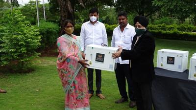 IISP Principal giving away Suraksha Box to a beneficiary.