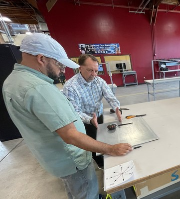 Eastern Florida Mechatronics Instructor Jean Paul Aliaga, left, and Space Coast Consortium Founder Bryan Kamm receive hands-on composites technician training at Davis Technical College—all part of IACMI-The Composites Institute's Advanced Composites Career Pathways program.