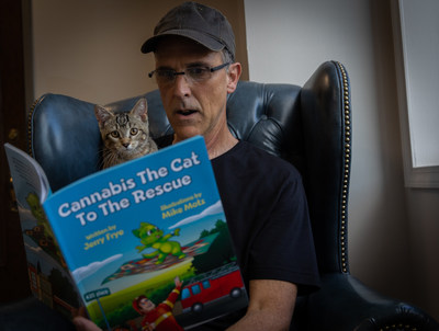 Author Jerry Frye pictured reading to his cat Cannabis