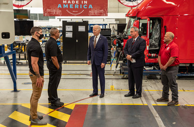 Mack Trucks today hosted President Joe Biden at its Lehigh Valley Operations (LVO) facility in Macungie, Pennsylvania, where all Mack heavy-duty models for North America and export are assembled. Left to Right, Stephen Villanueva-Medina, flex line production technician, Glenn Gray, shop floor manager, President Joe Biden, Martin Weissburg, Mack Trucks president and Kevin Fronheiser, UAW Local 677 shop chairman, talk during a tour of Mack's LVO facility.