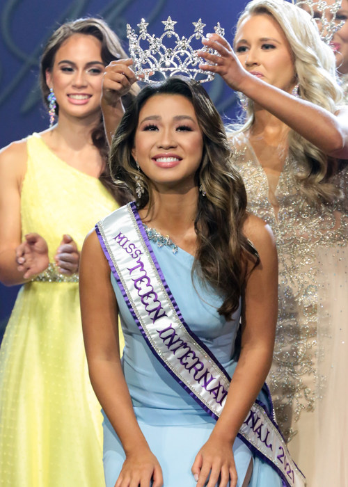 Miss Teen International 2021, Katie Hoang, of Keller, Texas, is crowned by Miss Teen International 2020, Jadyn Luberto, during the annual final competition held July 31 in Kingsport, Tennessee. Photo credit:  Paul Preston Photographer