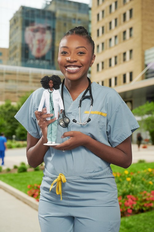 Canadian physician, Dr. Chika Stacy Oriuwa, is recognized for her contributions as a frontline medical worker during the pandemic with One-of-a-Kind Barbie doll made in her likeness. (CNW Group/Mattel Canada, Inc.)
