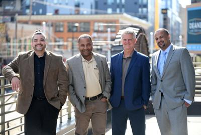 Brown Venture Group Managing Partner Dr. Chris Brooks, partner Jerome Hamilton, partner Chris Dykstra, and Managing Partner Dr. Paul Campbell outside their Minneapolis office.