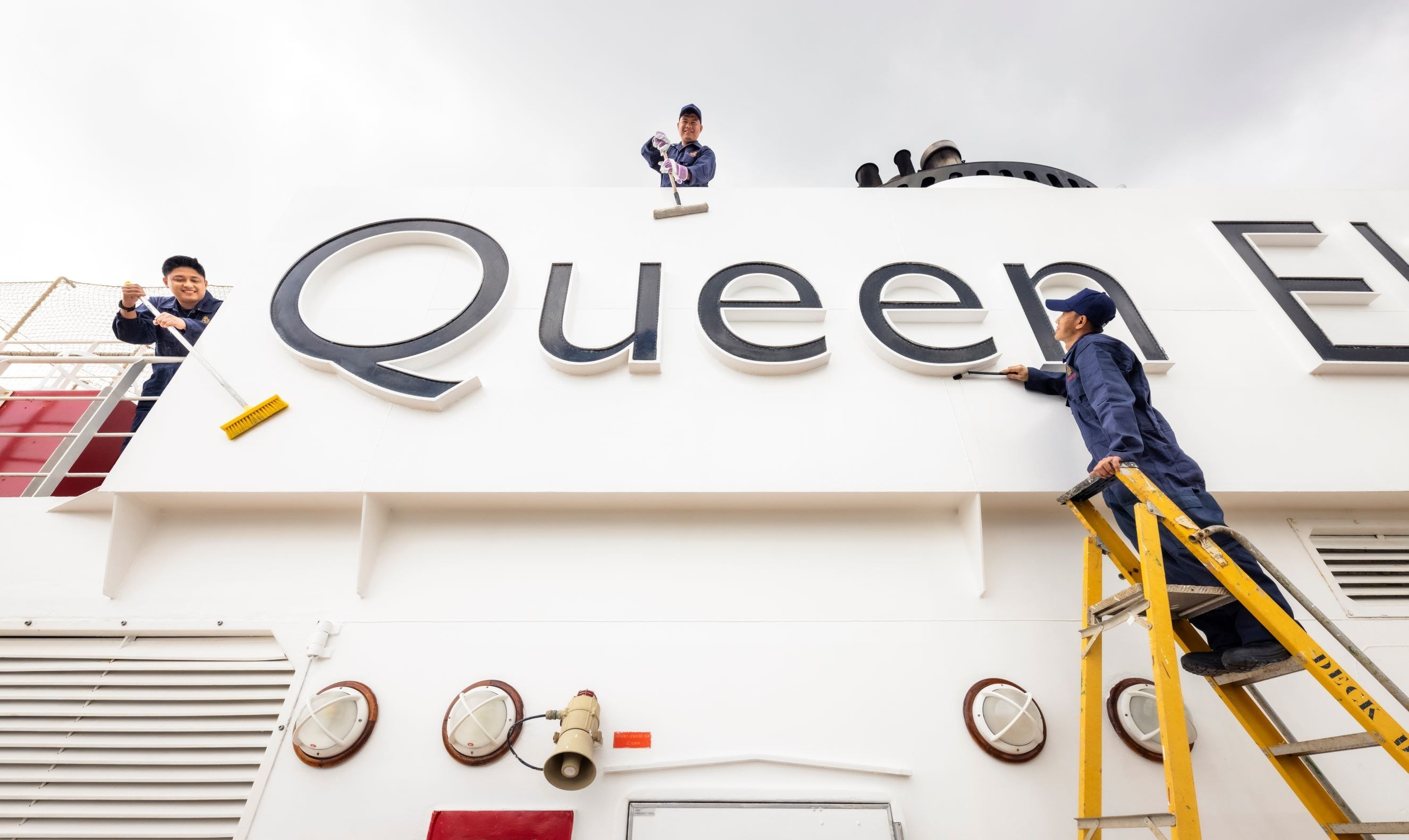 Crew members make final touches aboard Cunard's Queen Elizabeth in preparation for her return to sailing on Friday August 13, 2021. The ship will first sail a series of UK voyages before returning to international sailings in October  (August 2021)