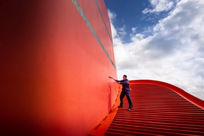 Crew members make final touches on the iconic funnel aboard Cunard's Queen Elizabeth in preparation for her return to sailing on Friday August 13, 2021. The ship will first sail a series of UK voyages before returning to international sailings in October.