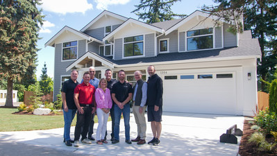 MN Custom Homes and Jubilee REACH celebrate the completion of the home.