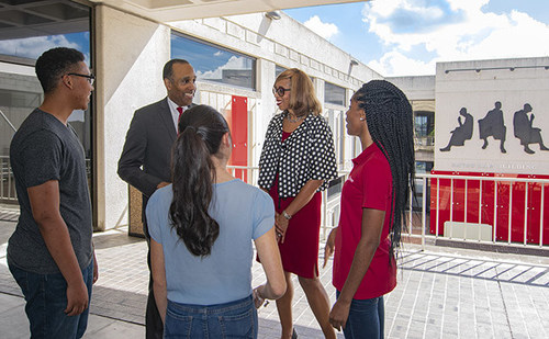 University of Houston Law Center Dean Leonard M. Baynes and Associate Dean for Alumni & Community Relations Sondra Tennessee chat with students between classes.