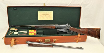 Winchester 1895 Deluxe takedown rifle, manufactured in 1913, deluxe two-barrel set (405WCF and 35WCF calibers). Comes with French fitted oak and leather case, period cleaning tools and box of ammunition for each caliber. Provenance: Estate of Mike Wilson. Estimate $5,500-$8,500
