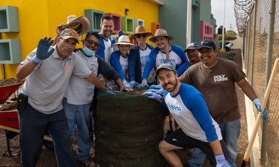 The USANA Foundation team meeting planting garden towers in Mexico.