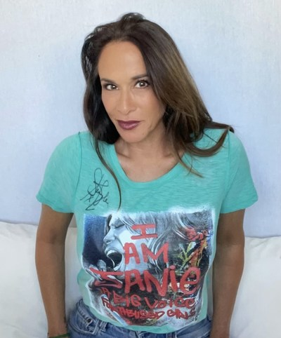 """Writer and actress Kristin Dattilo, who portrayed """"Janie"""" in the award-winning video for """"Janie's Got A Gun"""" in her one-of-a-kind Steven Tyler tee. Only 100 of these unique upcycled tees are available starting Aug. 16 - autographed by Steven Tyler and benefiting Janie's Fund."""