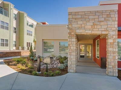 The Enchanted Springs apartment community features many shared amenities, including golf course views, walking trails, a spa and massage room, playground, and access to public transportation.
