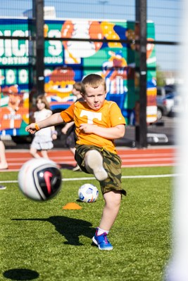 A young athlete plays soccer on the field during the grand opening of DICK'S House of Sport in Knoxville, TN.