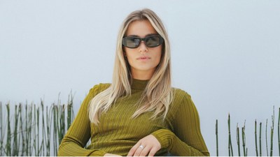 A model wearing Ostendo's OST3™ Wearable Display prototype featuring one QPI® per eye and third-party beam splitter optics, which are wirelessly connected to a smartphone. (Photo courtesy of Ostendo Technologies, Inc.)