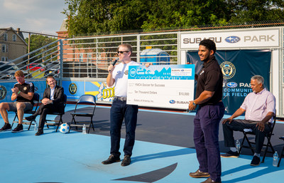 Alan Bethke of Subaru of America presents donation check for $10,000 to the YMCA of Greater Philadelphia to support Soccer for Success. Pictured Left to Right: Jim Curtin, Head Coach of Philadelphia Union, Charlie Slonaker, Chief Revenue Officer of Philadelphia Union, Alan Bethke, Sr. VP of Marketing of Subaru of America, Justin Spencer-Linzie, Executive Leader of Greater Philadelphia YMCA, and Victor Carstarphen, Mayor, City of Camden.