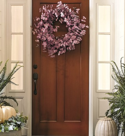 Chic transformation of the fall front door decor wreath as Eucalyptus leaves bow to the earthy subtle color trends for 2021 at Ballard.