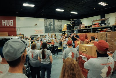 Team Rubicon Greyshirts hold a pre-deployment brief to discuss the scope of their mission at the National Operations Center before heading out to Louisiana to assist those affected by Hurricane Ida. (Photo Credit: Team Rubicon)