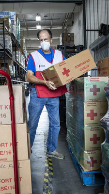 Red Cross volunteer Don Meyn of Baton Rouge stacks comfort kits to be shipped to nearby emergency shelters. (Photo credit: American Red Cross)