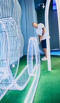 The indoor Lounge by Topgolf will feature a 9-hole mini golf experience