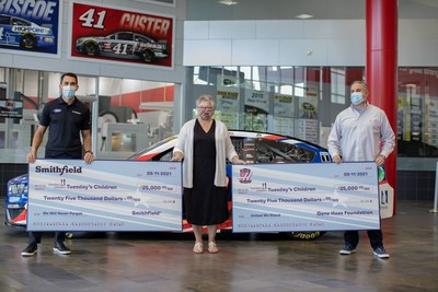 To commemorate the 20th anniversary of Sept. 11, representatives from Smithfield & the Gene Haas Foundation recognized Tuesday's Children – an organization formed in the wake of 9/11 that provides support to those who have been affected – with a $50,000 donation at Stewart-Haas Racing's headquarters in Kannapolis, N.C.. (left to right: Aric Almirola, NASCAR driver, Lisa Oosterom, Chief Financial Officer at Tuesday's Children, Mike Arning, Vice President of Communications for Stewart-Haas Racing)