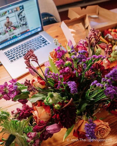 A Tailored Twig client takes a photo of their final arrangement after attending a Tailored Twig Virtual Design Studio class.